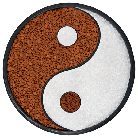 opposites: Ying Yang symbol of harmony and balance, background of instant coffee and sugar