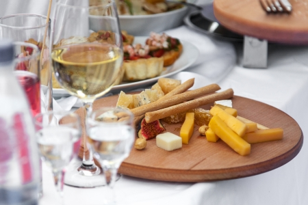 cheese and other appetizers on a desk Stock Photo - 15357520