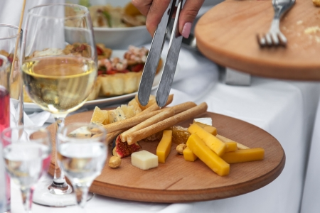 cheese and other appetizers on a desk Stock Photo - 15357511