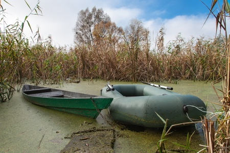 Old wooden and modern inflatable boat Stock Photo - 16025514