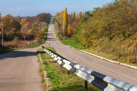 guardrail: Autumn landscape with road
