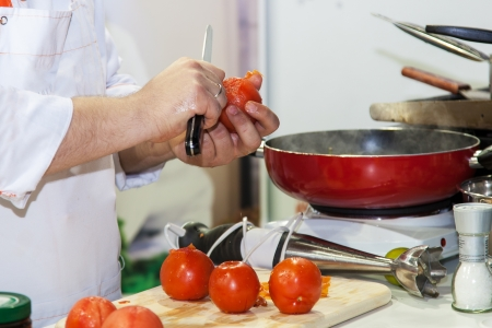 Chef prepares tomatoes for vegetarian meals
