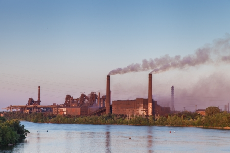pollution water: Old Metallurgical Works on the riverside  Industrial landscape Stock Photo