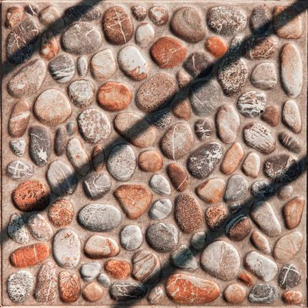 harsh: Paving slabs pebble in bright sunlight, harsh shadows Stock Photo