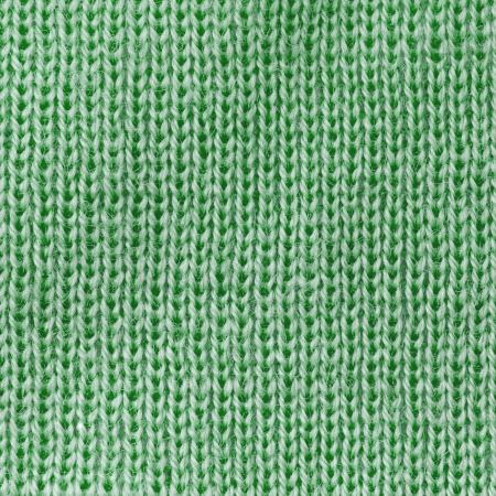 Green knitted fabric texture abstract background
