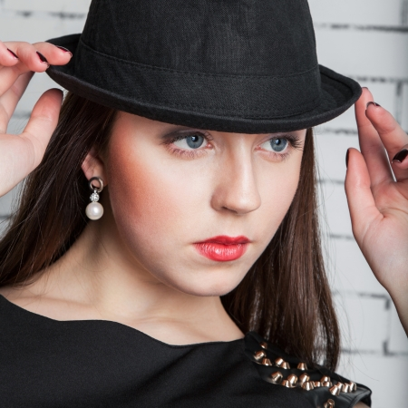 18's: Portrait of glamour stylish young female with fashionable female hat