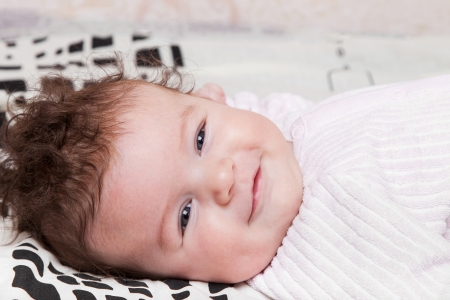 Portrait of a smiling baby girl closeup photo