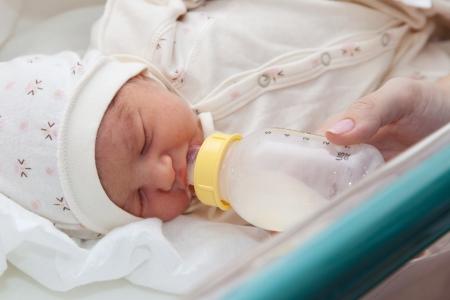 Feeding a newborn baby in maternity hospital