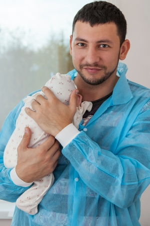maternity ward: Happy father holding a baby in the maternity ward Stock Photo