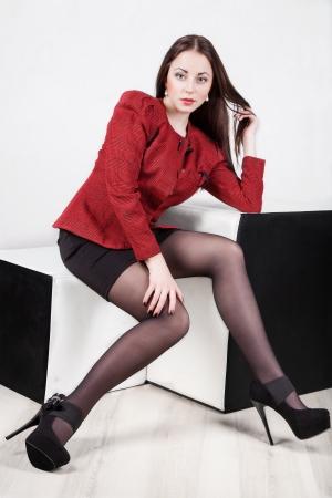 leggy: Leggy girl posing in studio laying on the floor with legs raised up