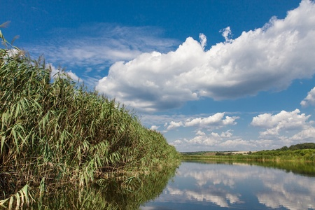 River landscape against of blue sky with white clouds photo