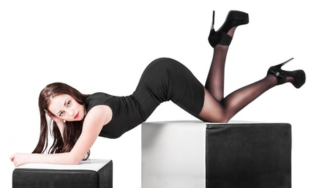 provocative women: Beautiful young woman demonstrates a high heels Stock Photo