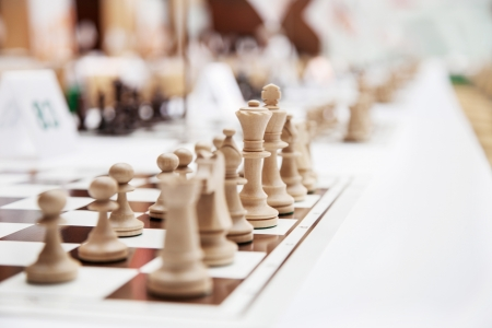 Chess with wooden figures at the beginning of the chess tournament photo