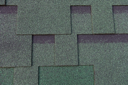 Texture of bitumen shingles close up abstract background photo