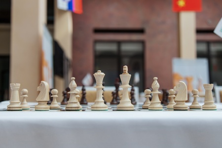 Wooden chess pieces on the chess tournament photo