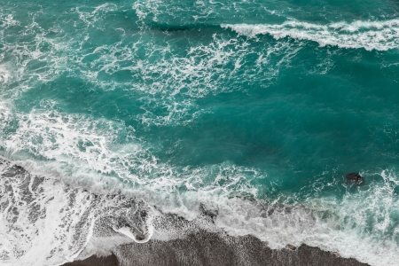 Seashore with rolling waves, view from a height of 300 meters
