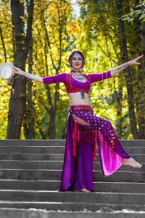 Oriental Dancer on stairs in the park photo