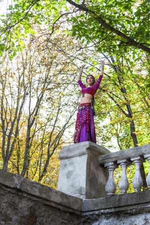 Oriental dancer with saber in the park photo