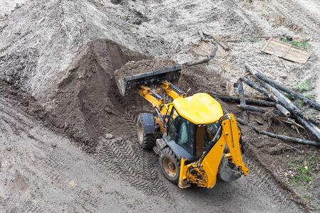 Repair of heating, bulldozer digging the ground photo