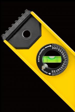 calibrated: Closeup shot of spirit level for construction work isolated on black background Stock Photo
