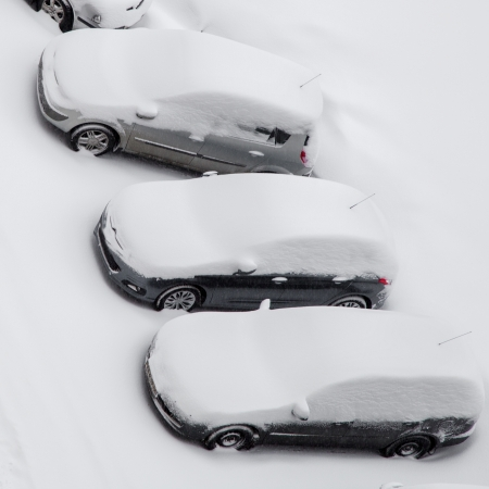 Cars covered by snow after snowstorm, top view Stock Photo