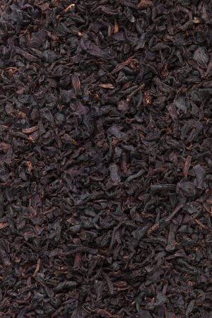 theine: Black tea dried leaves natural texture closeup Stock Photo