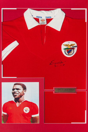 silva: KIEV,UKRAINE, March 8, 2013: studio shot T-shirt and photo of legendary Portuguese footballer Eusebio da Silva Ferreira with authentic autograph. Eusebio died on the night of January 5, 2014 Editorial