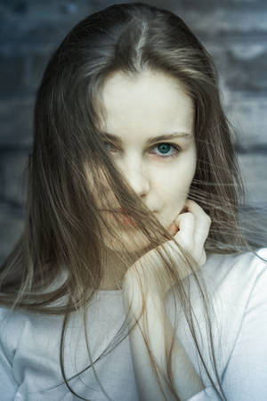 Toned portrait of a stylish young woman photo