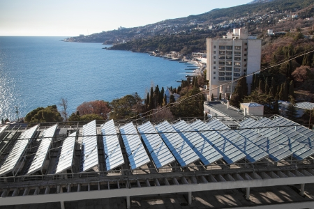 gelio: Solar panels on the roof of building Stock Photo