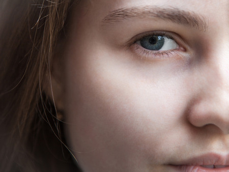 Part of a female face without makeup closeup