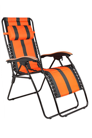 Studio shot of a sun lounger with orange stripes, isolated on white background with clipping path photo