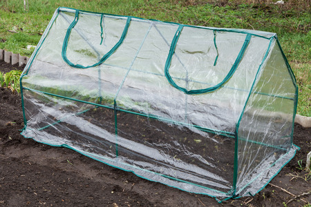 collapsible: Frame collapsible mini greenhouses installed in the vegetable garden