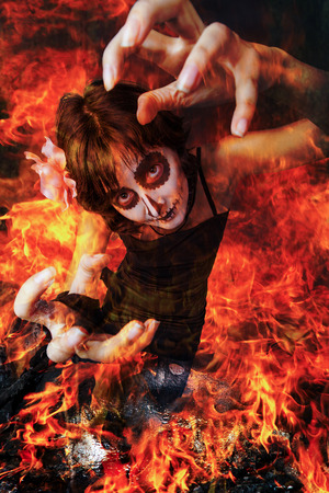 World Apocalypse, zombie woman with her ??mouth sewn rose from the flames of hell photo