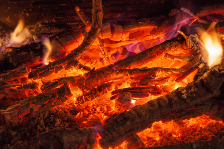 Background of smoldering wood in a fireplace closeup Stock Photo