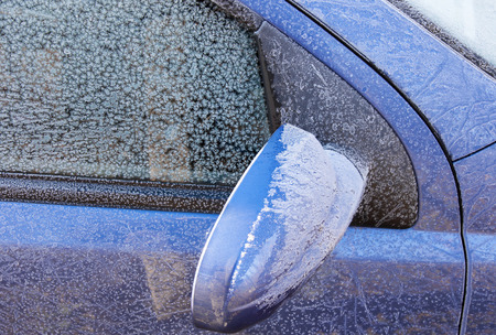 mornings: Frozen surface of the car during winter mornings
