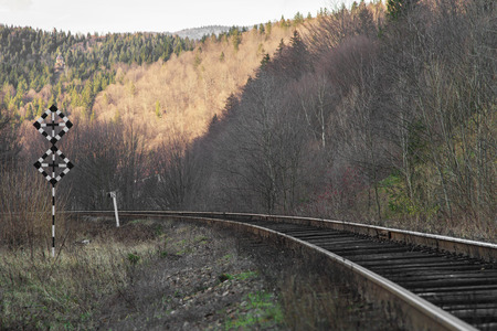 Railway in a mountainous area receding into the distance photo