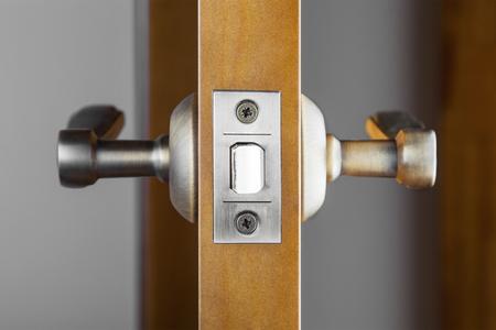 ajar: Opened wooden door with latch handle closeup