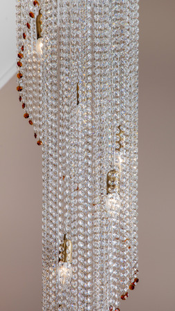 architectural lighting design: Fragment of crystal chandelier on a dark background Stock Photo