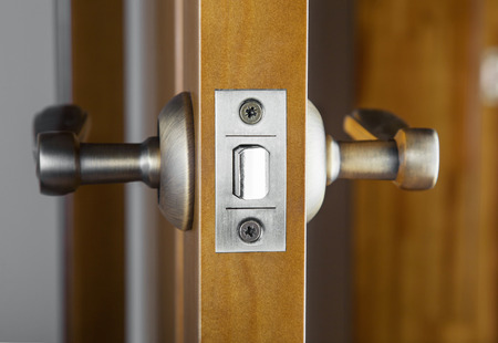 front end: Opened wooden door with latch handle closeup