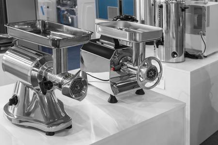 Two machine for mincing meat, presentation equipment Foto de archivo