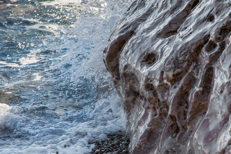 celadon blue: Sea wave is incident on rocky shore