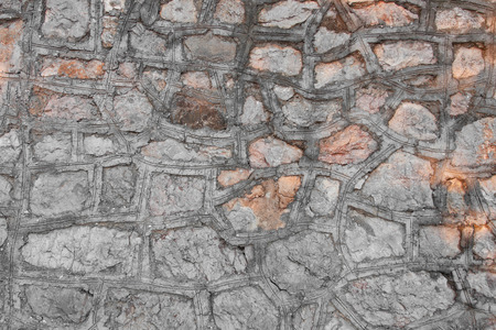 masonry: The old masonry of granite, abstract background