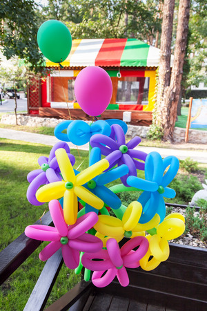 Balloons shaped in form of flower outdoors