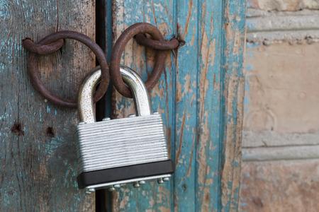 hasp: Photo of the padlock and old metal hasp closeup