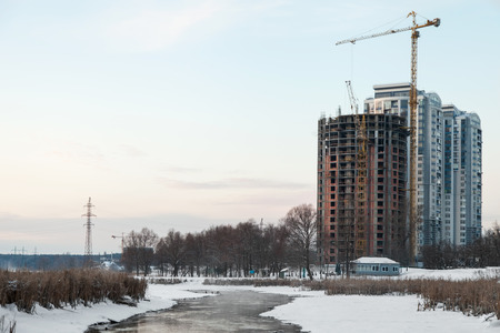 unfinished building: Unfinished building on the river bank in winter