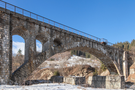 the medieval: Old stone railway bridge in mountains Carpathians, Ukraine