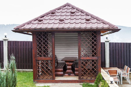 Wooden garden house for relaxing, metal tiles roof Stock Photo