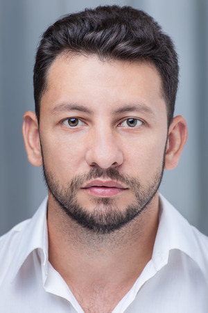 pakistani ethnicity: Middle eastern young attractive man with beard, studio portrait