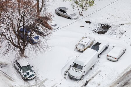 snowstorm: Cars in the parking lot after snowstorm view from above