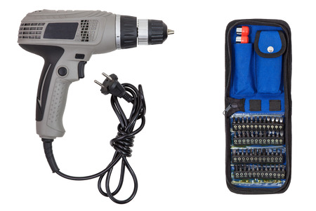 toolset: Electric tool screwdriver with set bits (heads, tips) in case, isolated on white background Stock Photo